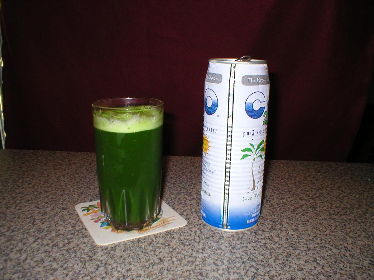 Juicing And Drinking Wheatgrass
